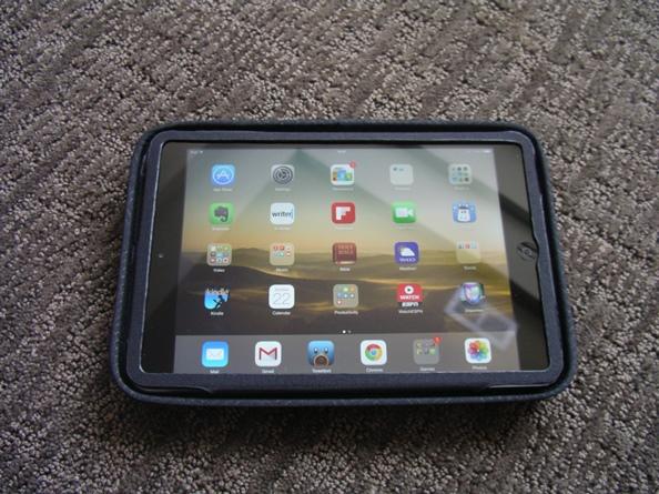 iPad Mini flipped into the top hard shell