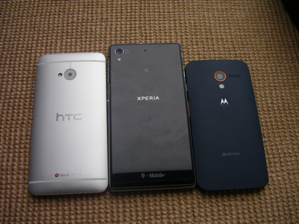 Back of the HTC One, Xperia Z1s, and Moto X