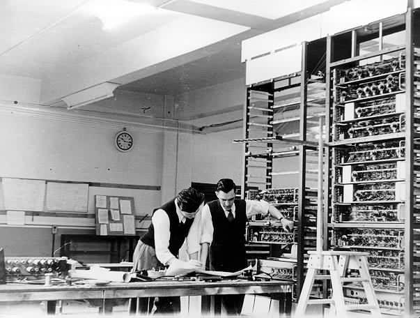 Lyons engineers Gordon Gibbs and Ray Shawlook looking at a LEO circuit diagram