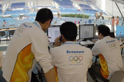 Lenovo technicians test equipment at the Beijing National Aquatics Center