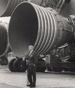 Wernher von Braun dwarfed by the F-1 engines of the Saturn V S-IC.