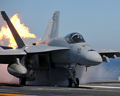 A Super Hornet taking off from the USS Abraham Lincoln Flight Deck