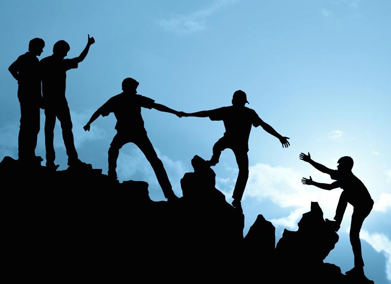 group-of-people-on-peak-mountain.jpg
