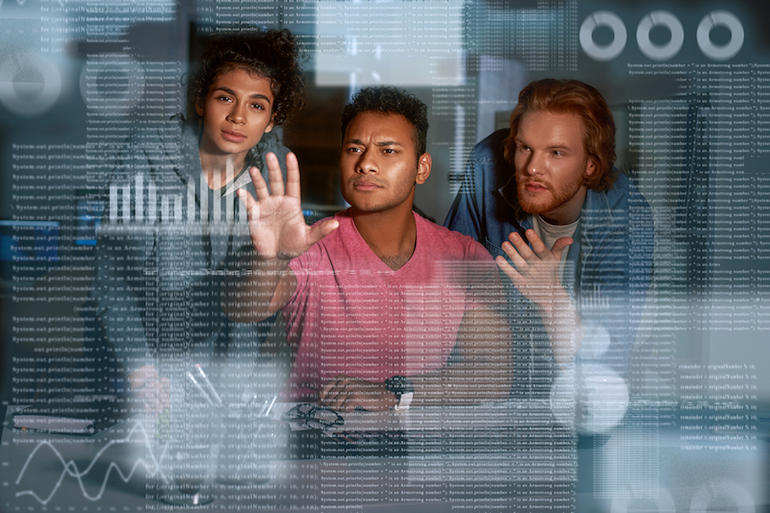 Young team of data analysts are looking over the data