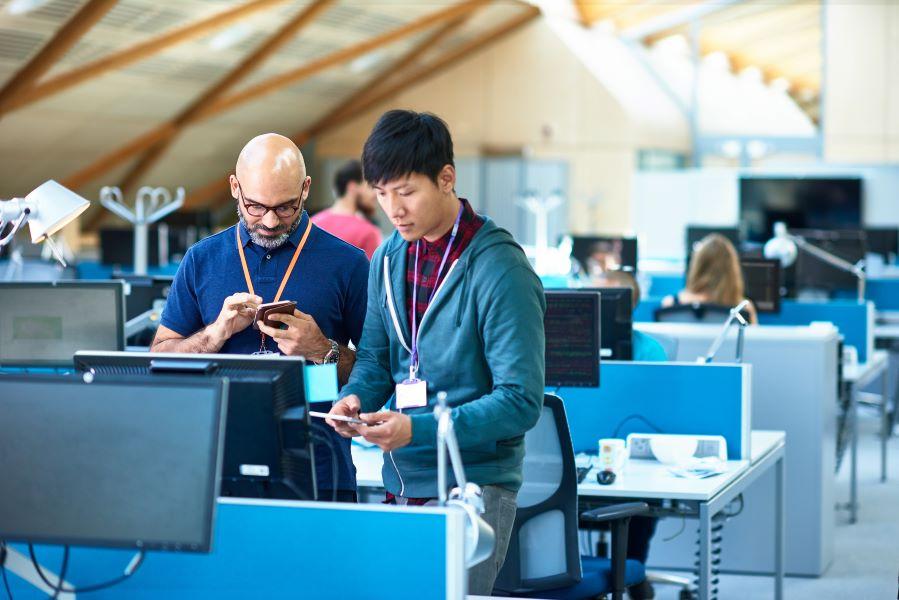 tech-workers-office-developers-desk-collaboration.jpg