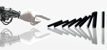 robot-hand-knocking-down-dominoes-small.jpg