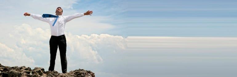 businessman-celebrates-clouds