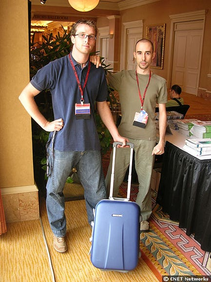 Researchers with suitcase