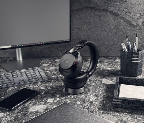 jabra-evolve2-85-uc-black-docked-office.jpg