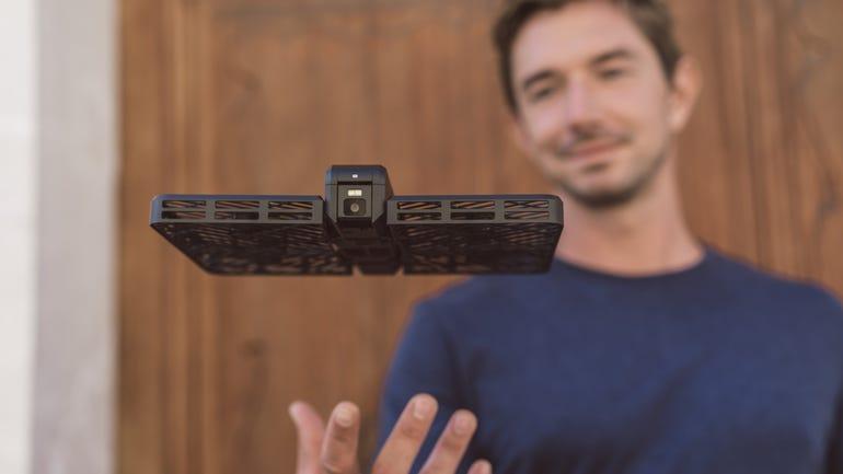 hover-camera-passport-hovering-over-hand.jpg