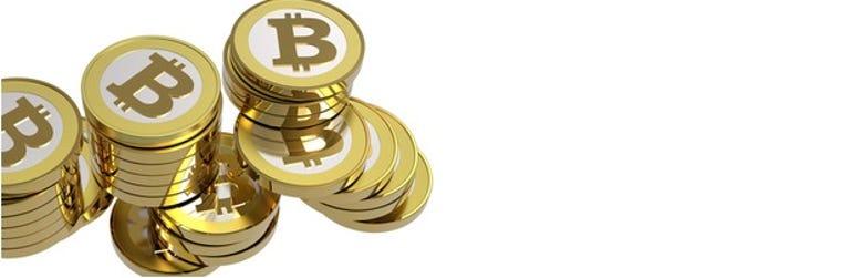 bitcoins-pile-620x202