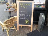 Bitcoin accepted at this cafe in the Netherlands (http://en.wikipedia.org/wiki/File:De_Waag_Bitcoin.jpg)
