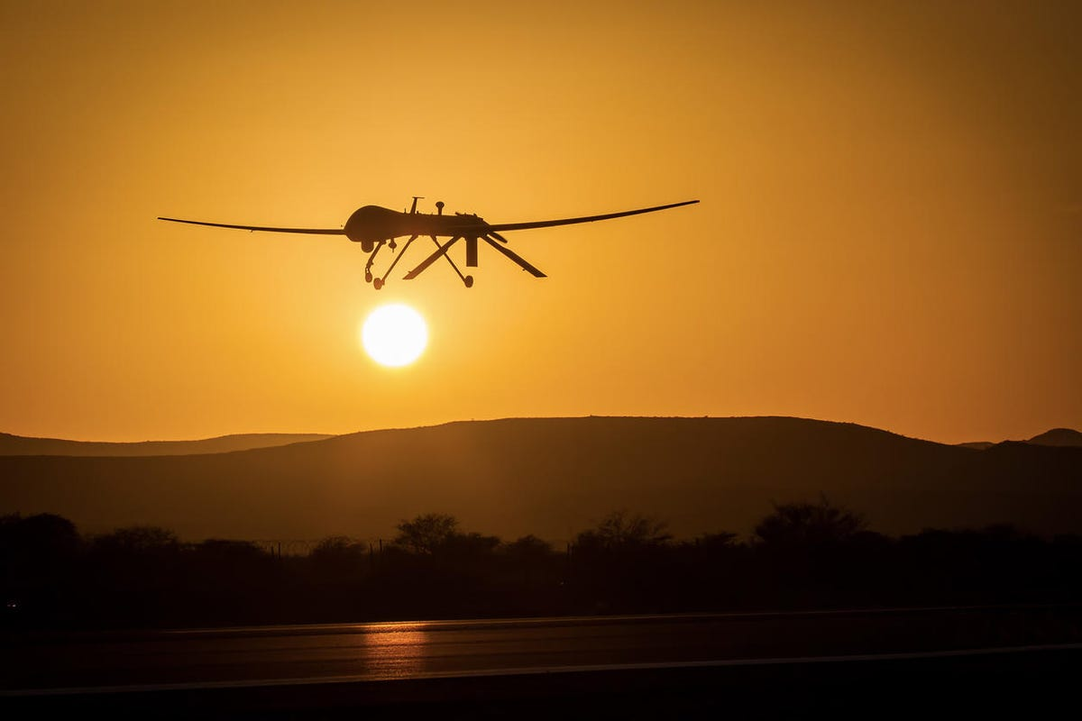 unmanned drone low pass in sunset panorama landscape