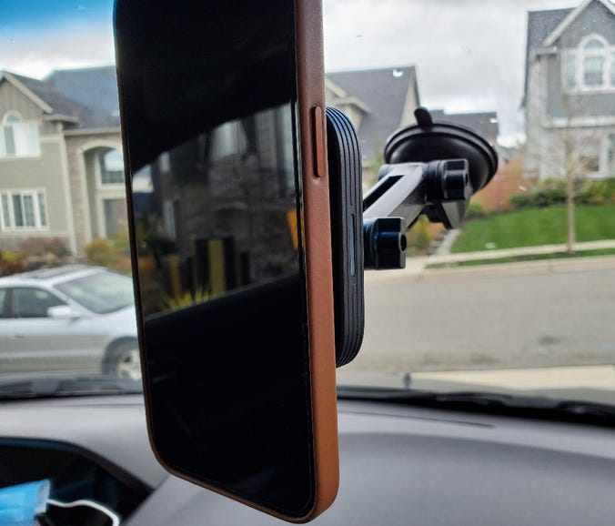 iPhone 12 Pro Max mounted on the ESR HaloLock Dashboard Wireless Charger