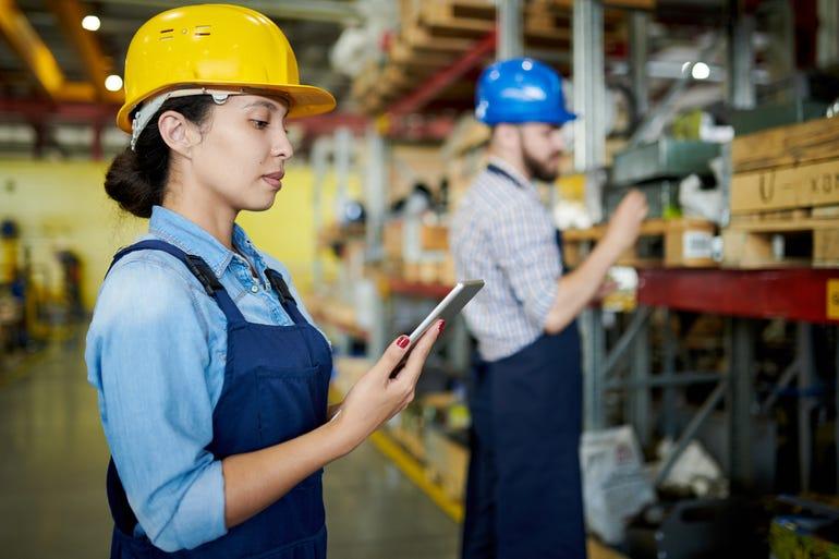 female-worker-reviewing-stock.jpg