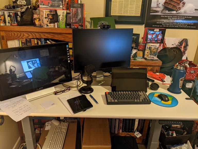 A couple monitors, computer, and more in place