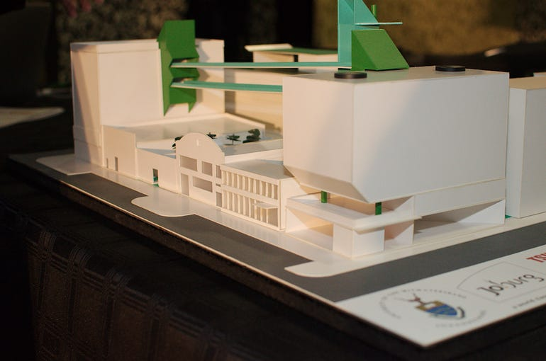 An early architect's model for the final development.