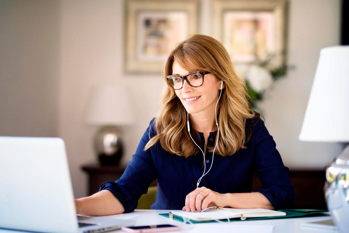 Shot of smiling businesswoman on video conference while working from home