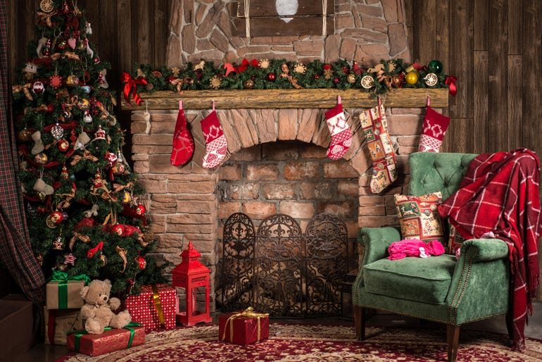 Christmas decorations of the room: fireplace, chair, tree