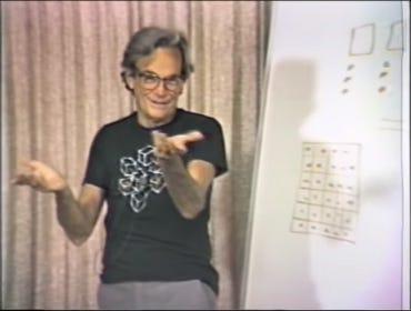 richard-feynman-lecturing-1980s.jpg
