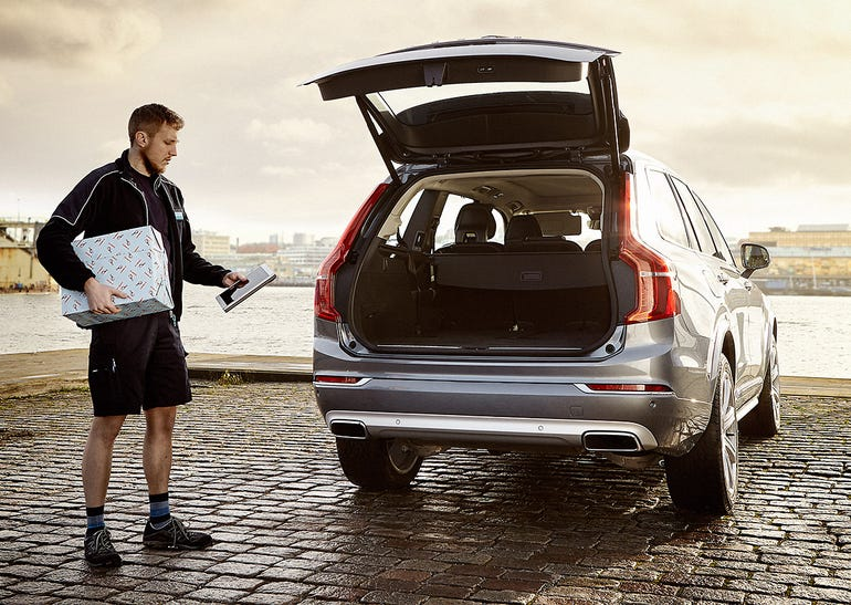 Delivering packages to the back of a Volvo car...