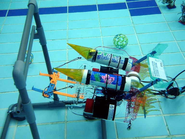 An underwater robot attempts to navigate an obstacle.