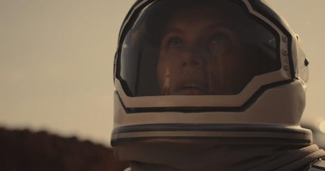 Astronaut opening helmet