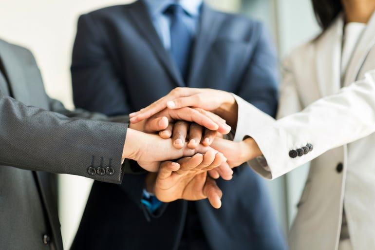 business hands team