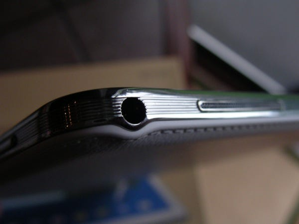 Headphone jack and volume button on the upper left