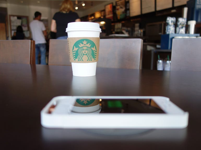 A Powermat charger in use at a branch of Starbucks