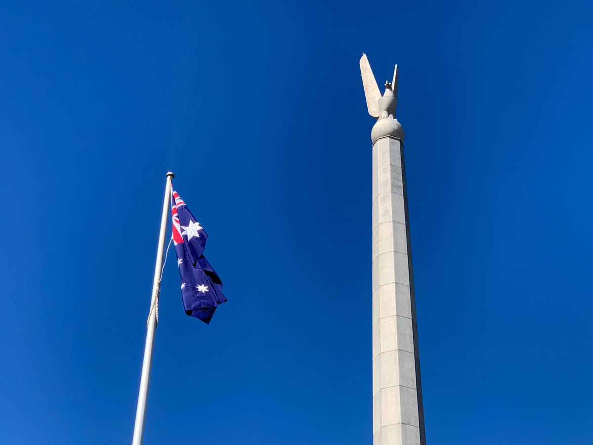 australia-australian-canberra-department-of-defence-russell-office-bird-statue-with-flag.jpg
