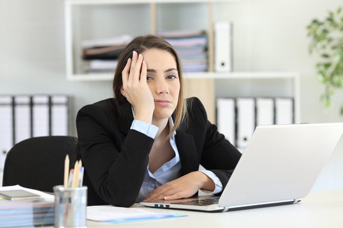 Frustrated executive looking at camera at office