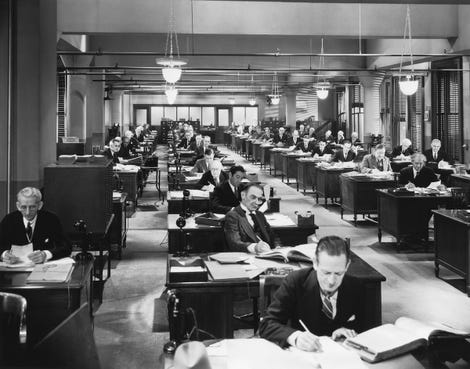 Vintage office building interior with people working at their desks