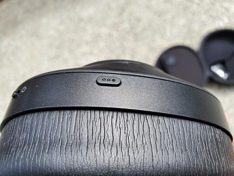 Left ear cup mode change button