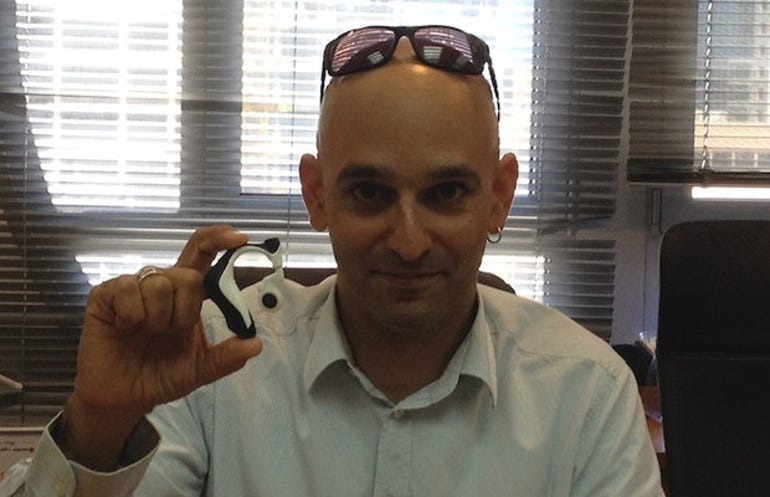 Ronen Sofer, director of Intel's Herzliya development center, holds up an earpiece containing Jarvis technology. The Herzliya center was 'involved' in the development of Jarvis, Sofer said