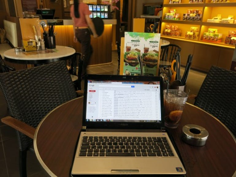 Laptop in coffee shop in Ipoh, Perak