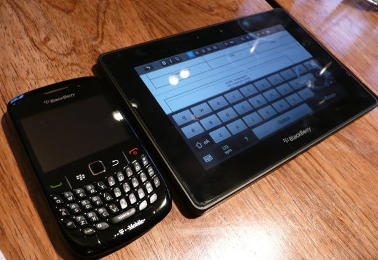 BlackBerry PlayBook shown next to a BlackBerry Curve