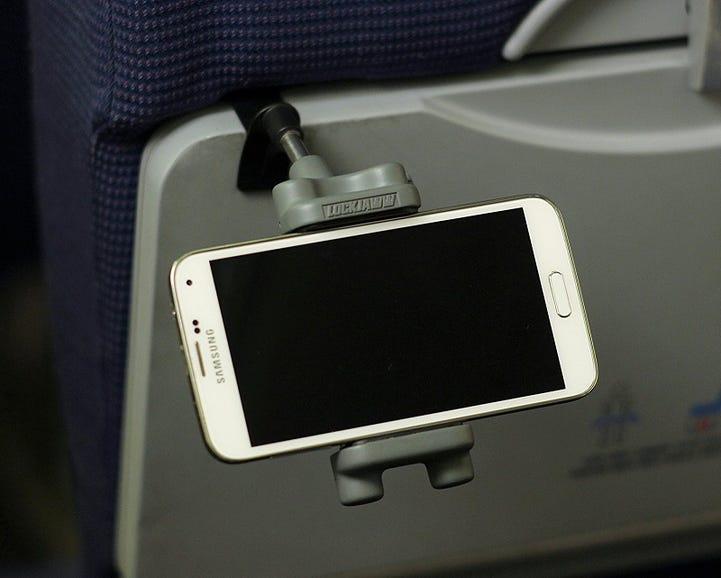 Lockjaww in-flight device holder