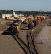 Two trains merging in Portland, Oregon, from This Space for Rent