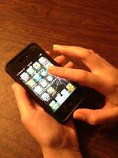 iPhone in use-photo by Joe McKendrick