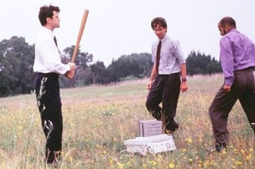 The famous and parodied fax machine mugging scene in the cult classic Office Space  (Credit: Steve McCutchen)
