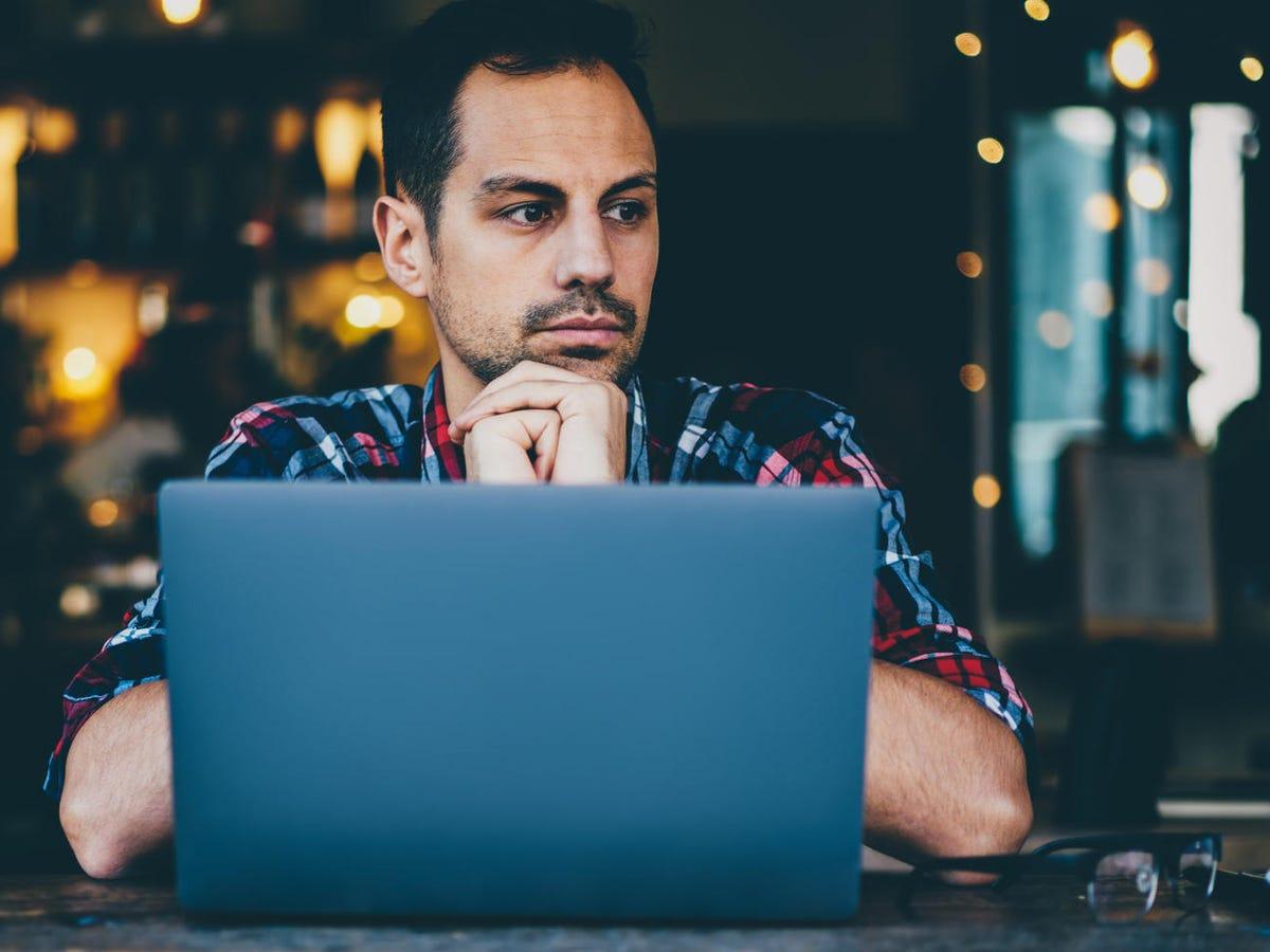 Developer sitting at laptop computer