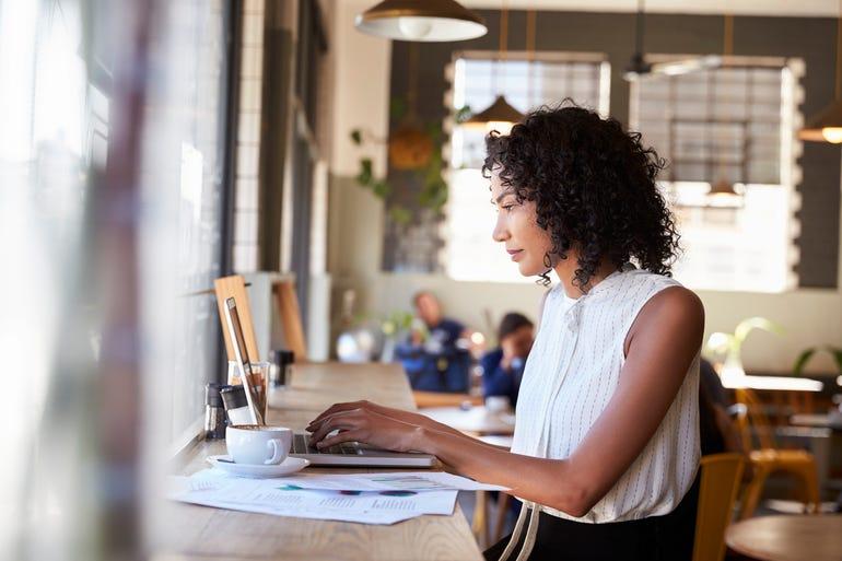 businesswoman-by-window-working-on-laptop.jpg