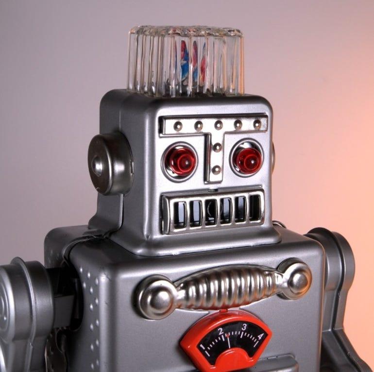 reprosmokingspacemanrobot-hahatoy-silver-closeup1.jpg
