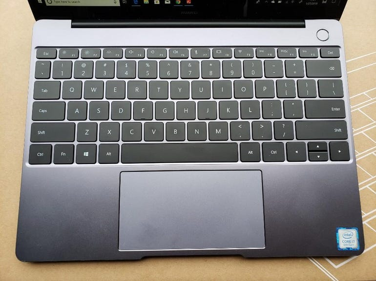 Full keyboard and extra larger trackpad