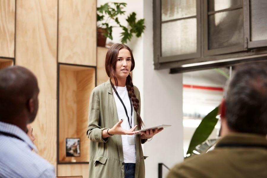 woman-presenting-presentation-meeting-feedback.jpg