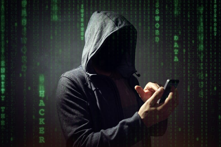 hacker-using-phone.jpg
