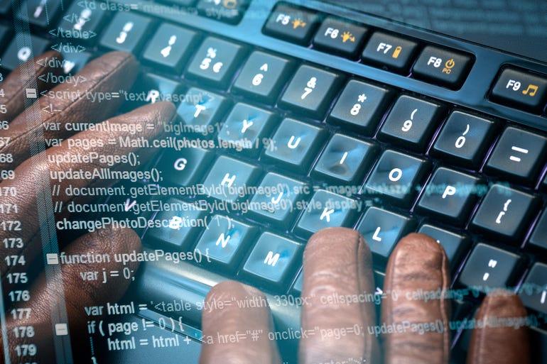 hacker-hands-and-code.jpg