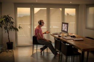 man-working-from-home-pajamas-remote-working-zoom-call.jpg