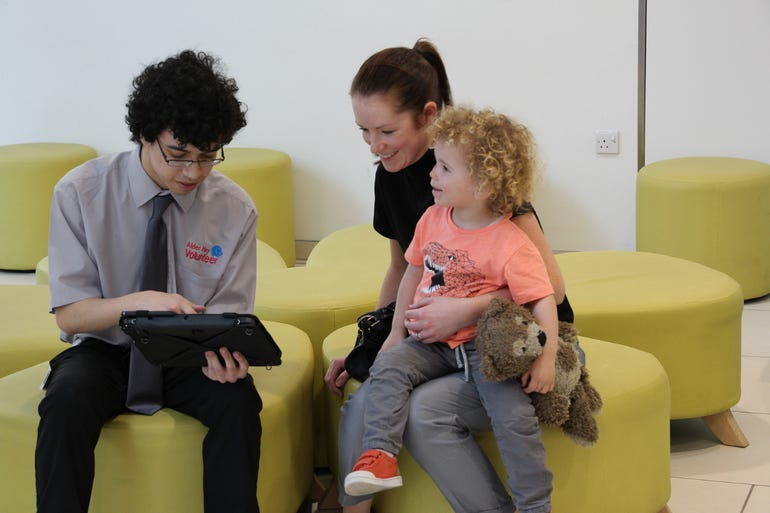 alder-hey-childrens-hospital-volunteer-gathers-feedback-from-a-family-about-their-experiences-at-the-hospital.png